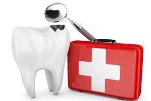 decayed tooth with first aid kit and dental mirror