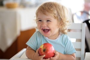 young child with apple