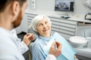 patient speaking to a dentist