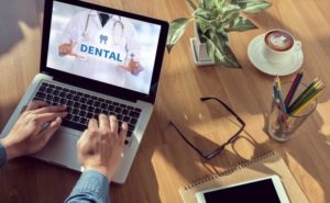 dental insurance form on laptop
