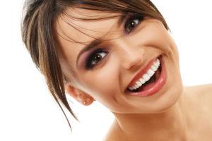 woman smiling with porcelain veneers in Peabody